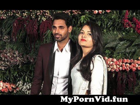 View Full Screen: bhuvneshwar kumar with wife nupur nagar at virat anushka reception in mumbai.jpg