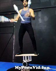 View Full Screen: circus artist juggles pins while balancing on rola bola.jpg