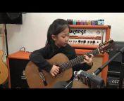Miumiu Guitargirl